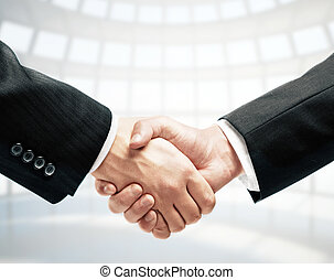 handshake and office on background