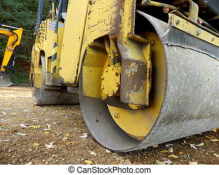 Road Compactor - Close up of a road compactor compacting a...