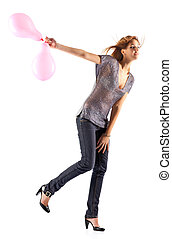 Young slim woman with balloons