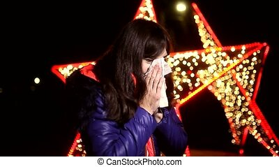 woman sneezing into a handkerchief cold influenza winter...