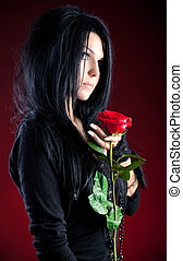 Goth woman with red rose