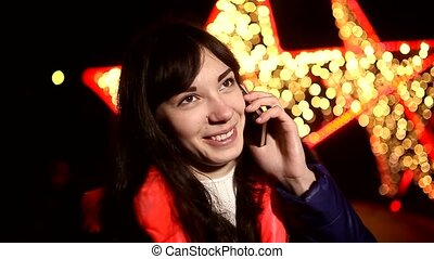woman girl talking on phone at night on a smartphone...