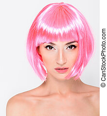 Head shot of young woman in pink wig on white background