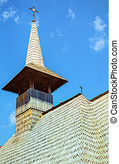 Wooden Bell Tower against the Sky