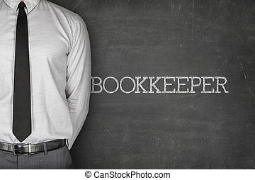 Bookkeeper text on blackboard - Accounting concept on...