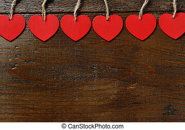 red hearts on wooden background - valentine day concept