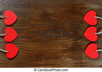red hearts on wooden background - valentine day