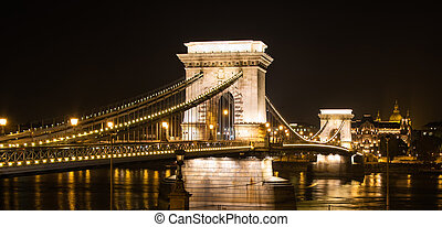 Illuminated Chain Bridge of Budapest at nighttime -...