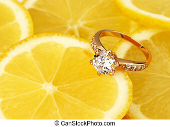 jewellery ring with big diamond on lemon background with copy space