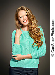 blue cardigan - Pretty young woman with beautiful curly hair...