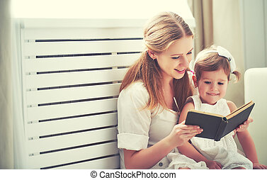 happy family mother child little girl reading book - happy...