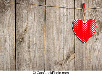 Red heart hanging on clothesline for Valentine Day - Still...