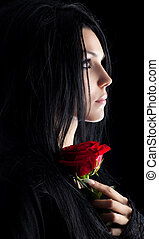 Brunette goth woman with rose portrait Dark colors