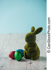 Easter eggs and a bunny on a white table