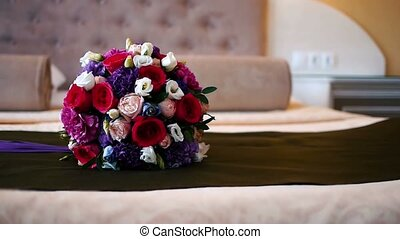 bridal bouquet lying on the bed