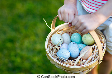 Colorful Easter eggs - Close up of colorful Easter eggs in a...