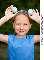 Little girl with Easter eggs