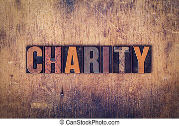 Charity Concept Wooden Letterpress Type - The word Charity...