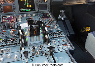 Airbus cockpit throttle lever - The black throttle lever in...