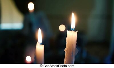 candles burning on the table