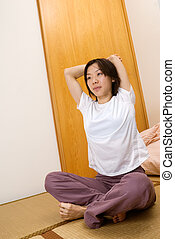 Woman excise at home, relax sport in room.