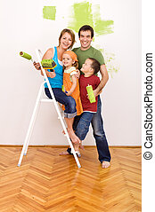 Happy family before redecorating their home - Happy family...