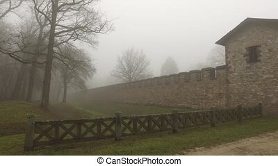 Rome Castle and Wooden Fence in Foggy Day
