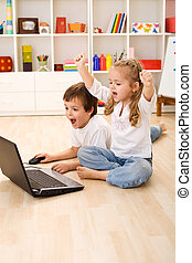 Excited kids about to win computer game - Stressed or...