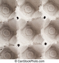 Empty egg carton package, top view above, close-up fragment...