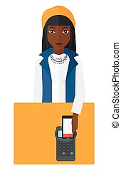 Customer paying using smartphone - An african-american woman...