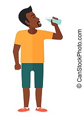 Man drinking water. - A sportive african-american man...