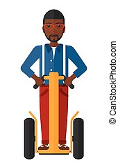 Man riding on segway. - An african-american man riding on...