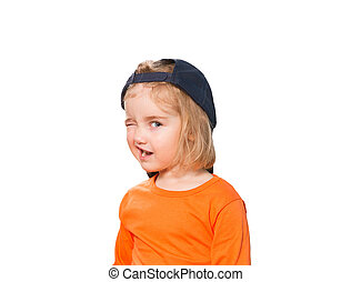Little Funny girl in baseball cap and orange blouse....
