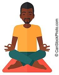 Man meditating in lotus pose. - An african-american man...
