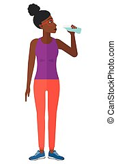 Woman drinking water - A sportive african-american woman...