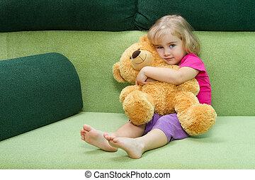 Little girl hugging a Teddy bear - Little girl hugging Teddy...