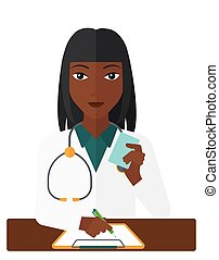 Pharmacist taking notes - An african-american pharmacist...