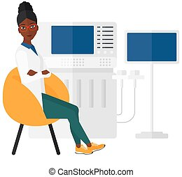 Female ultrasound specialist - An african-american female...