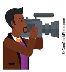 Cameraman with video camera - An african-american cameraman...