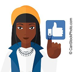 Woman pressing like button. - An african-american woman...