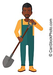 Farmer with spade. - An african-american farmer digging with...