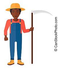 Farmer with scythe - An african-american farmer holding a...