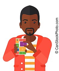 Man with modular phone. - An african-american man with...