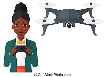 Woman flying drone - An african-american woman flying drone...