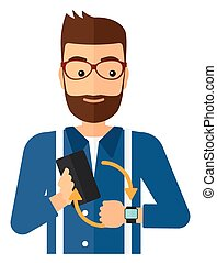 Synchronization of smartphone and smartwatch - A man holding...