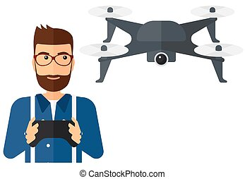 Man flying drone - A man flying drone with remote control...