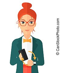 Synchronization of smartphone and smartwatch - A woman...