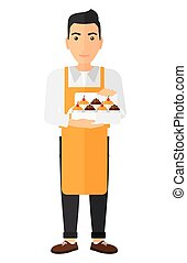Baker holding box of cakes - A man holding a box of cakes...