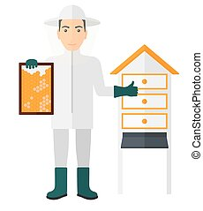 Bee-keeper at apiary - The beekeeper in protective suit...