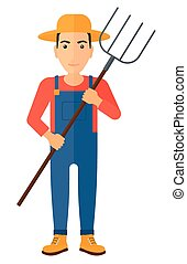 Farmer with pitchfork - A farmer standing with a pitchfork...